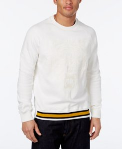This ribbed crewneck pullover is preppy and street at the same time, with a contrast color hem and a subtle tiger motif on the chest.