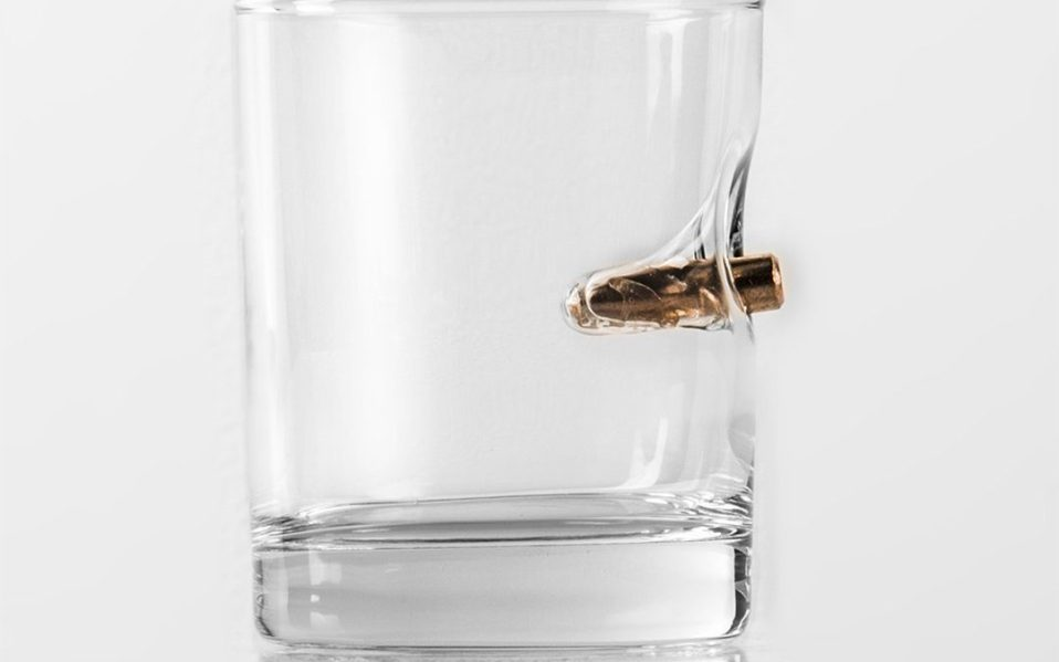 rocks glass with real bullet from