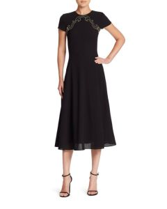 Made with the highest attention to detail and quality in Italy, this A-line wool dress features a flattering fit, silk lining and sophisticated embellishment along the collar. A true statement dress. $2290.00