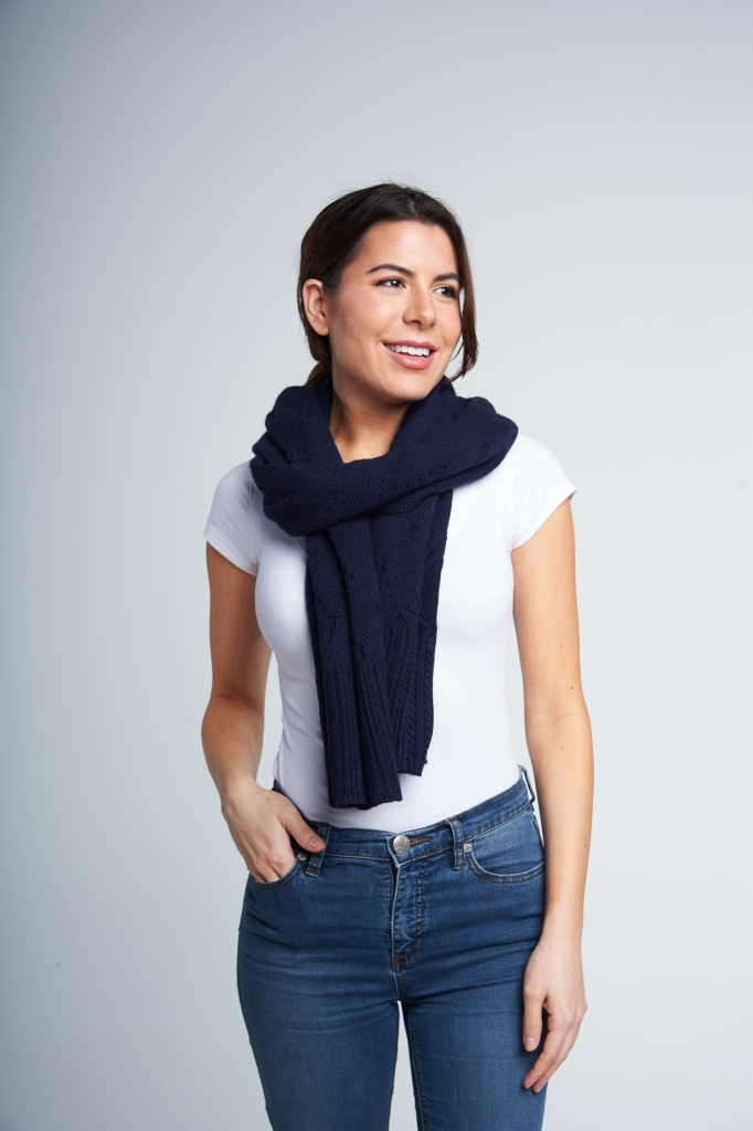 A slightly more intermediate way to tie a scarf, this one involves draping your scarf backwards, before bringing the ends around your neck and over your shoulders.