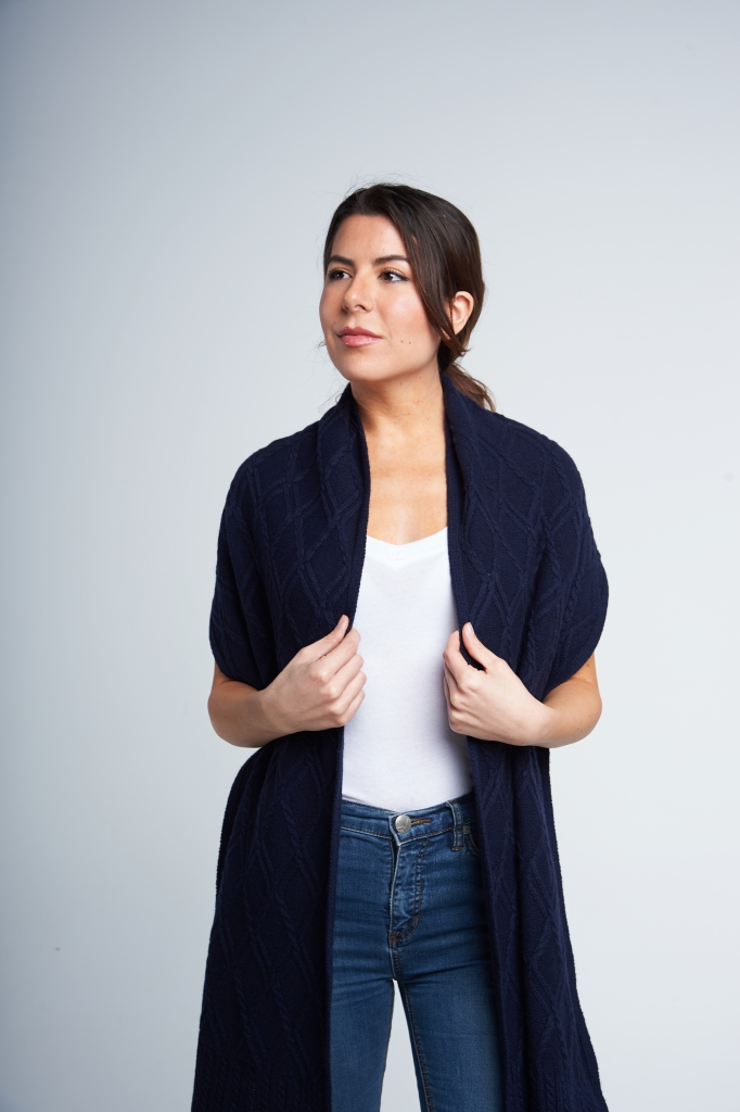 An oversized scarf doubles as a great statement shawl. Unfurl the scarf and drape it over your shoulders for warmth. A versatile look whether you're at a black tie gala or chilling at the cottage.