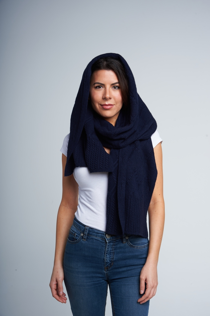 For days when you need protection from the elements, unfurl the scarf and wrap it over your head to stay warm and dry. Keep it looser rather than too tight to ensure that it reads more fashion and less head bandage.