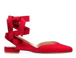 """The classic ballet slipper gets a feisty update! Crafted from sumptuous suede, these bright red lace-ups feature coordinating straps designed to wrap around the ankle. The shoes are cut low on the sides for an elegant and elongating effect. Bonus: use code ROOSTER at checkout for an exclusive Lunar New Year """"Red Packet"""" gift."""