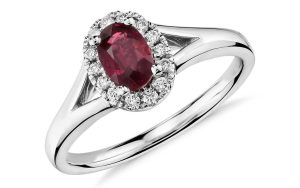 Oval Ruby and Diamond Halo Ring in 18k White Gold