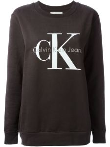 "The iconic CK logo sweatshirt is updated with a slightly looser fit and a faded black ""meteorite"" color."
