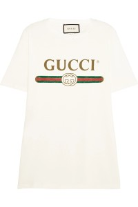 Inspired by an original 80s print, this oversized top is detailed with the label's signature gold Gucci lettering and red and green web motif.Thecream-colored cotton-jersey is distressed around the neckline for a cool, worn-in feel.