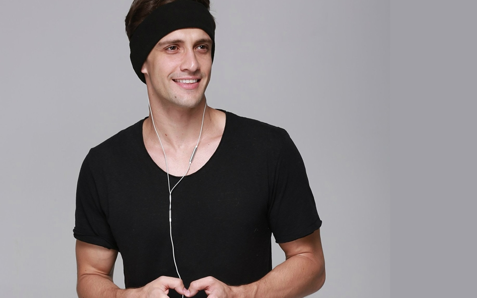 A Headband With Earbuds Built In