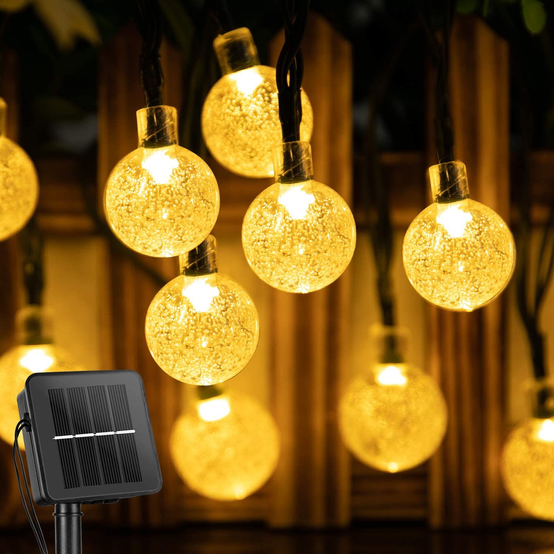 Brightown Solar String Crystal Globe Lights hung on a fence, best solar lights