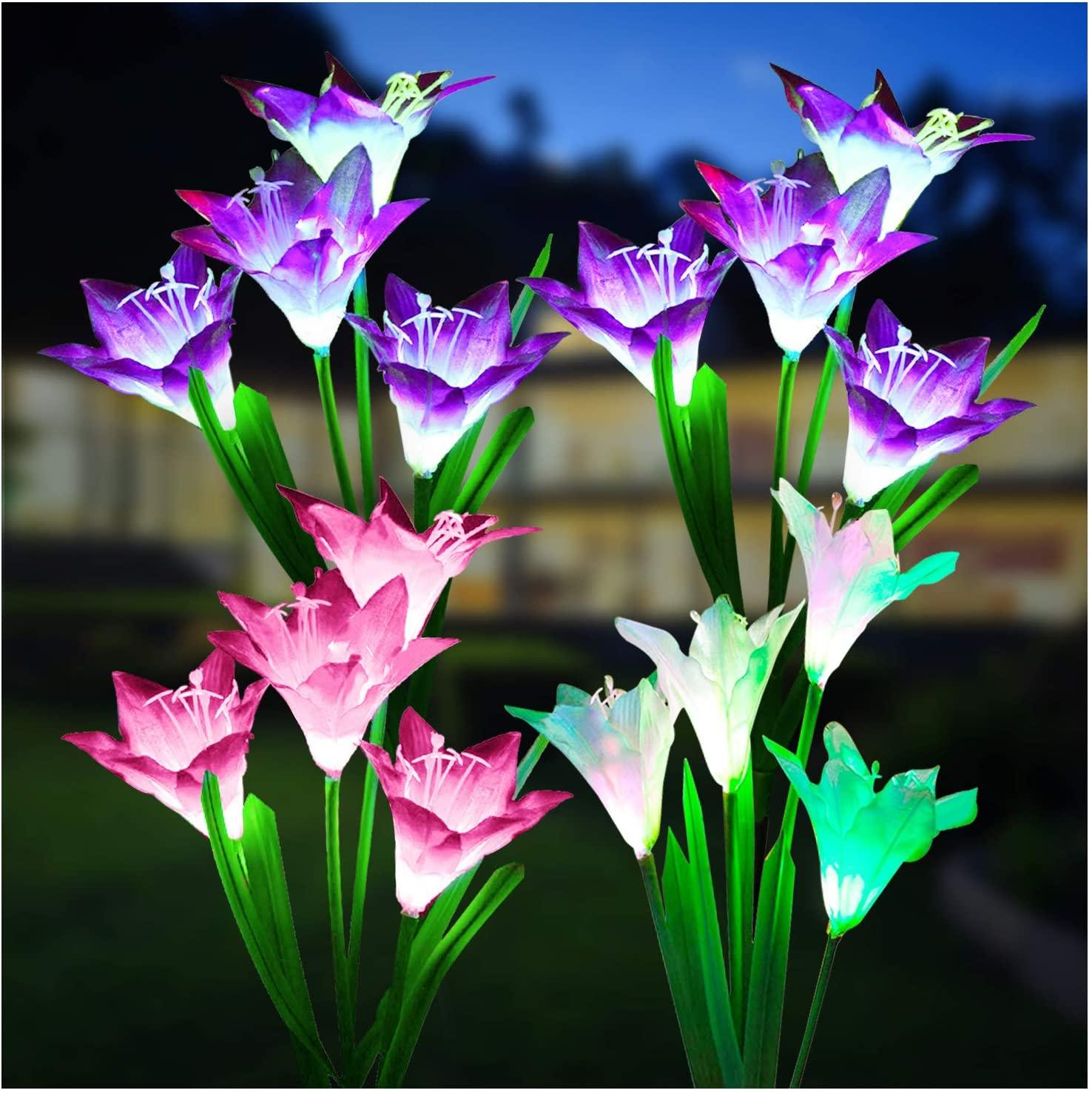 Four KOOPER solar garden lights that resemble lilies