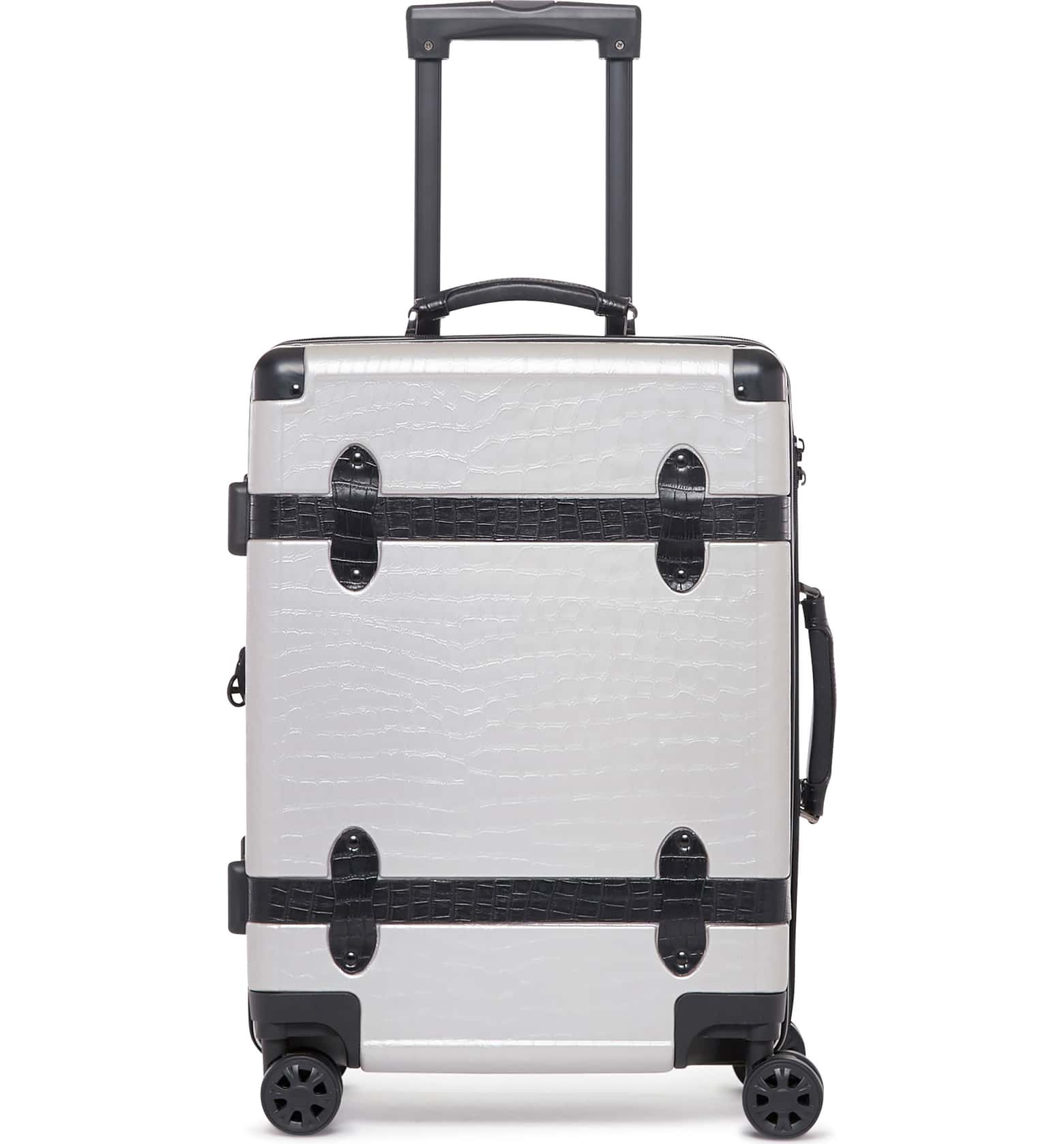 best luggage why invest in expensive suitcase travel tips carry-on calpak Trunk 22-Inch Rolling Suitcase