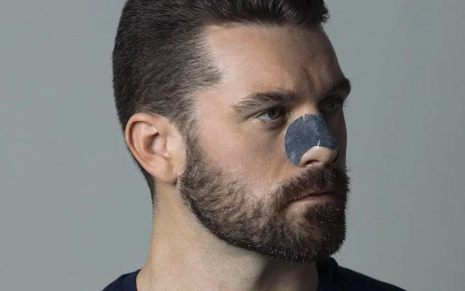 man wearing blackhead peel-off nose strip