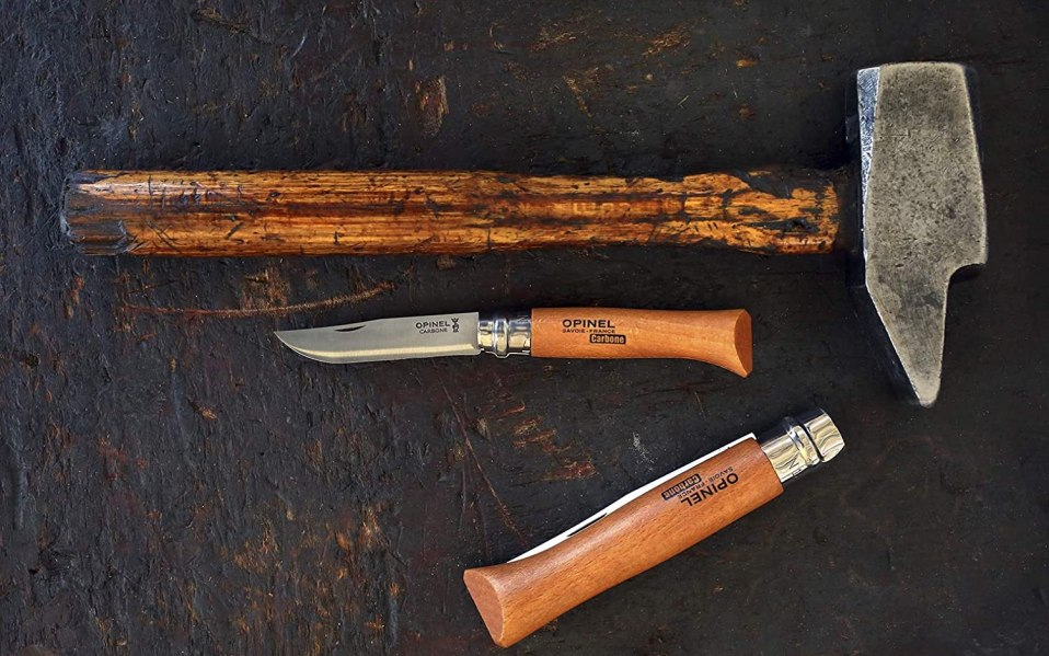 opinel knives and hammer rest on