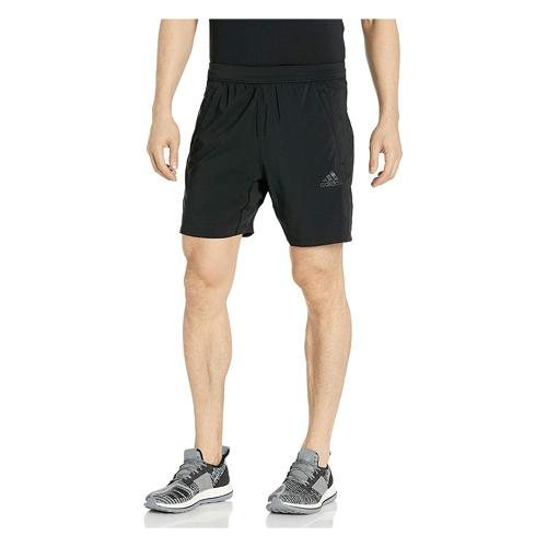 Man wears black Adidas Aeroready 3-stripes shorts