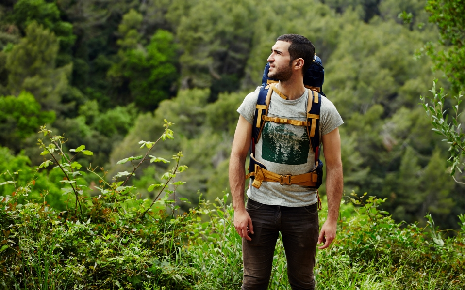man in jungle traveling