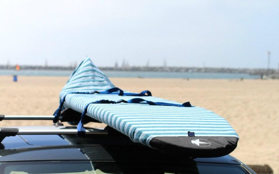 padded board bag on beach