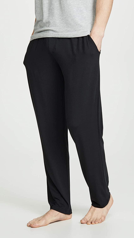 Man wears Calvin Klein Modal Pants in black; best men's loungewear