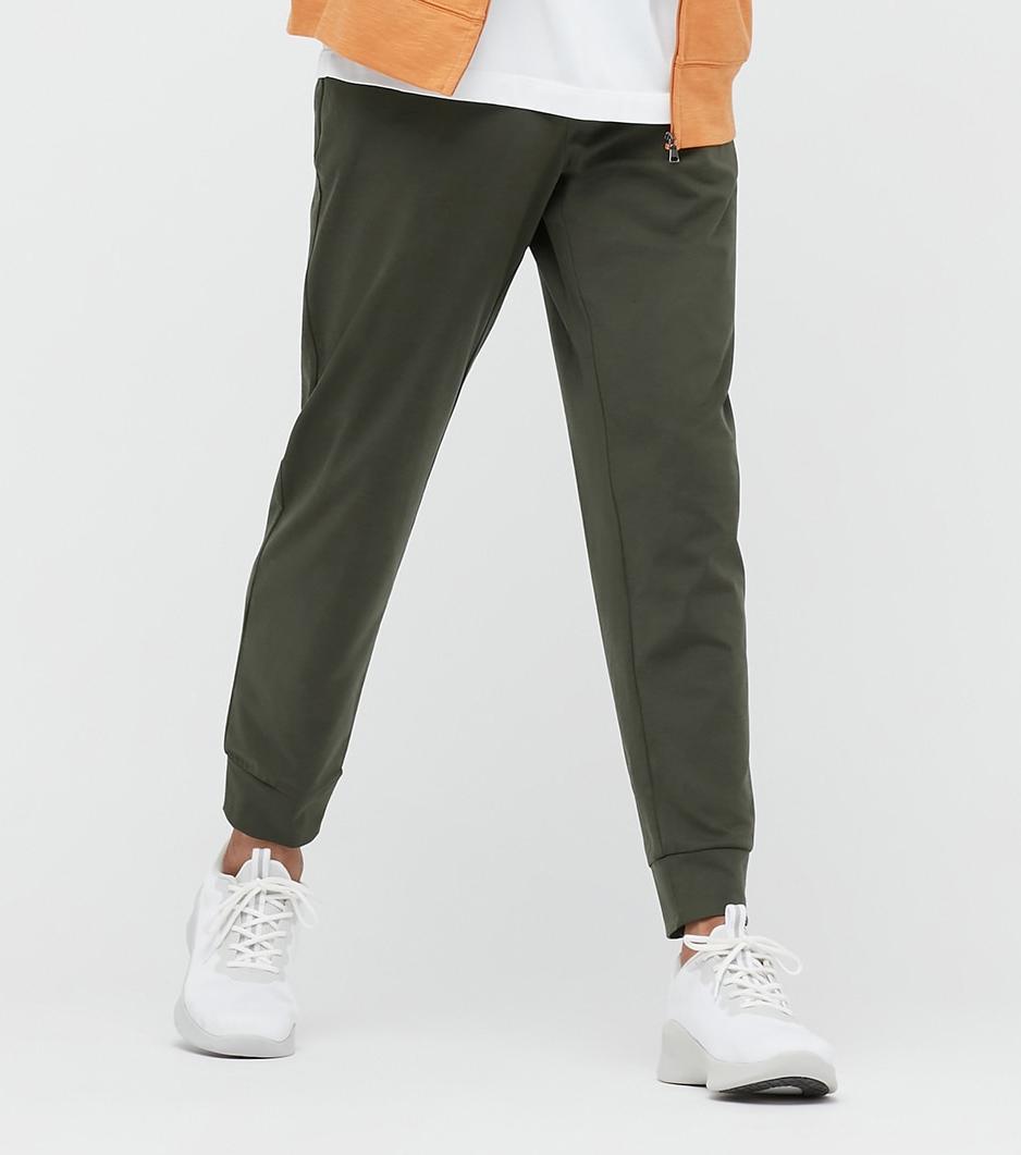 Man wears Uniqlo Men's Ultra Strech Active Jogger Pants in green; best men's loungewear