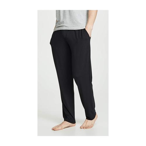 Man wears Calvin Klein Modal Pants in black