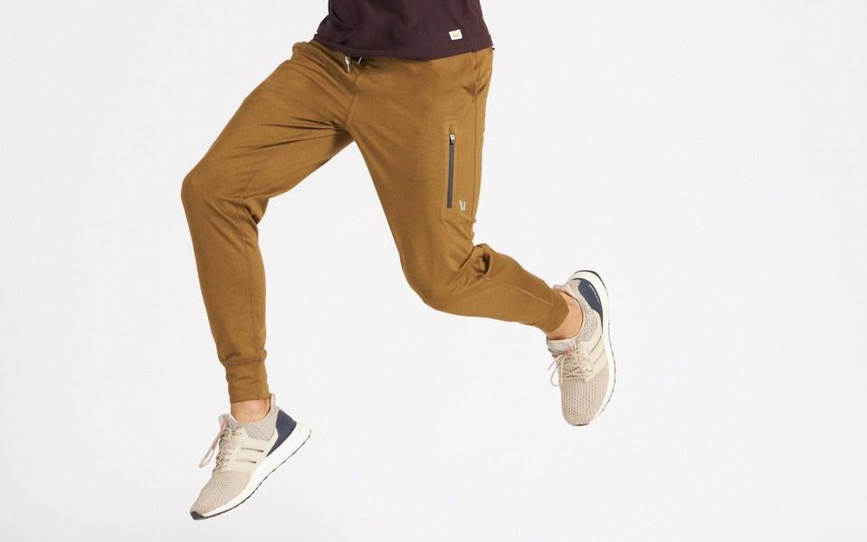 Man jumps through air wearing Vuori