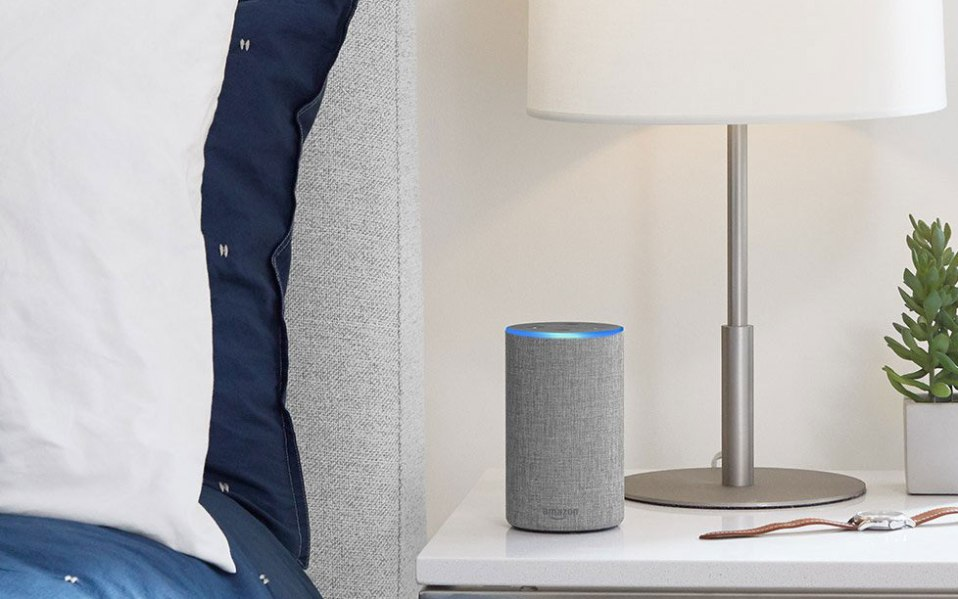 amazon echo sitting on a bed