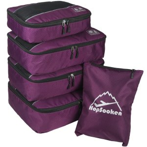 four hopsooken packing cubes and one shoe bag in deep purple