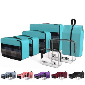 four yamiu packing cubes, two toiletry bags and a shoe bag in teal