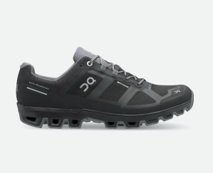 black trail running shoes with a cloud-like sole on a white background