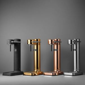 four aarke carbonated beverage makers lined up against a wall in metallic colors