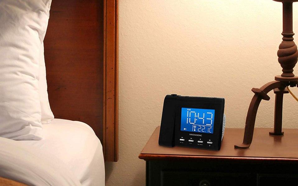 a digital alarm clock sitting on