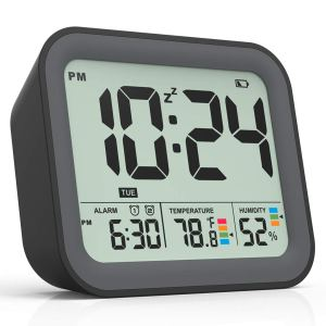 digital travel alarm clock on a white background
