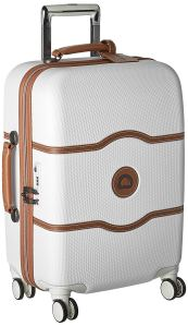 a white and beige delsey spinner carry on bag on a white background