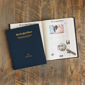 a new york times birthday book sitting on a wooden table
