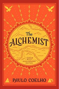 the alchemist by paul coelho on a white background