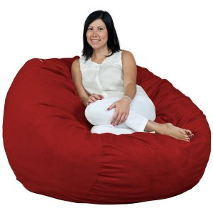 woman sitting in an adult-sized red bean bag chair