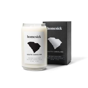 a candle and a box showing the state of south carolina with