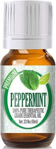 a glass bottle of healing solutions peppermint essential oil on a white background
