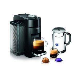 nespresso espresso machine making a cup of coffee alongside another full cup of coffee, two nespresso pods and a pitcher of water on a white background