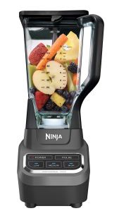 ninja professional blender full of fruit and ready to blend on a white background