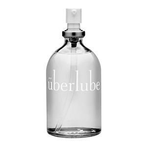 a spray bottle of uberlube on a white background