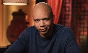 phil ivey poker pro looking at the camera while sitting at a poker table