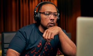 a picture of timbaland wearing headphones and working on a computer
