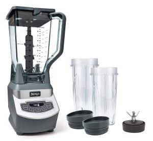 ninja professional countertop blender with two exra cups and lids on a white background