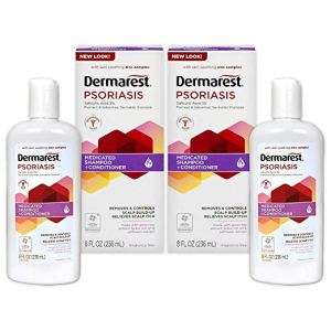 two bottles and two boxes of dermarest psoriasis shampoo on a white background