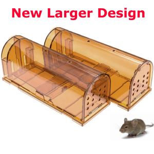 two orange plastic rat cages on a white background