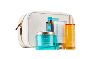 a set of moroccanoil beauty products with a small bag on a white background