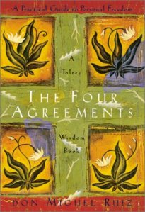the self-help book called the four agreements on a white background