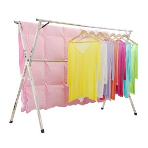 clothes and sheets hanging on a drying rack