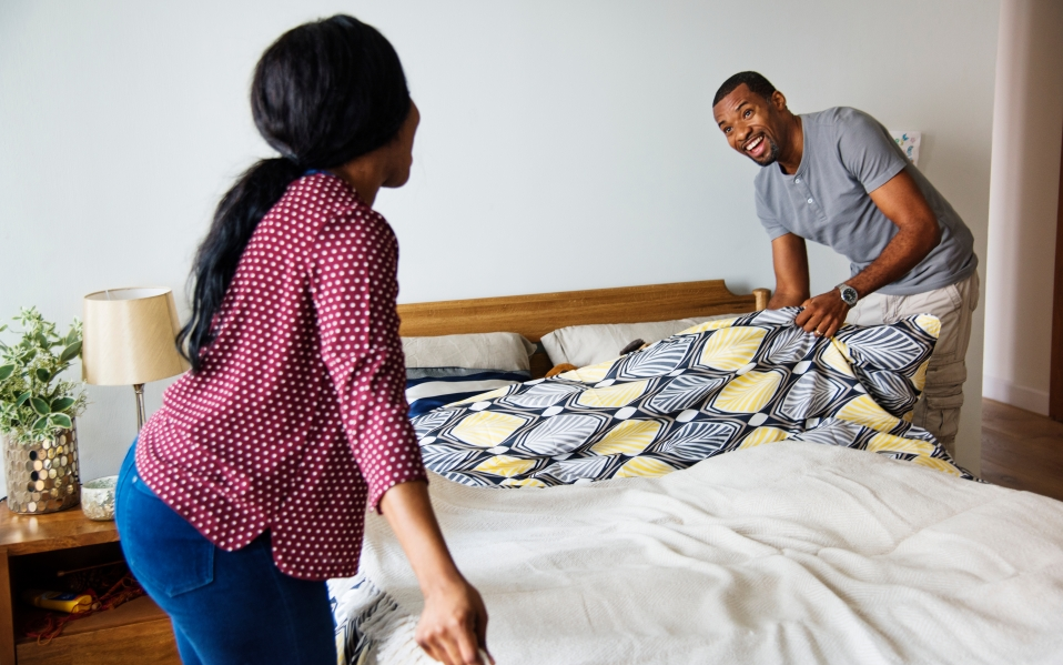 couple making the bed with fresh
