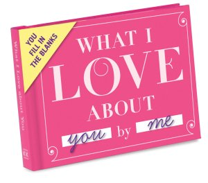 "a pink book with ""what I love about you by me"" written on the cover"