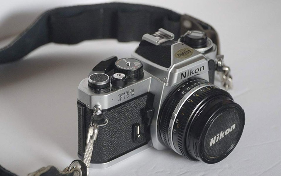 nikon 35mm film camera sitting on